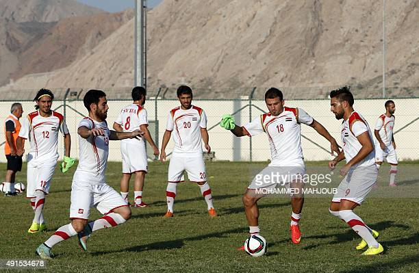 Syrian football players take part in a training session in the Omani capital Muscat on October 6 two days ahead of the 2018 FIFA World Cup qualifying...