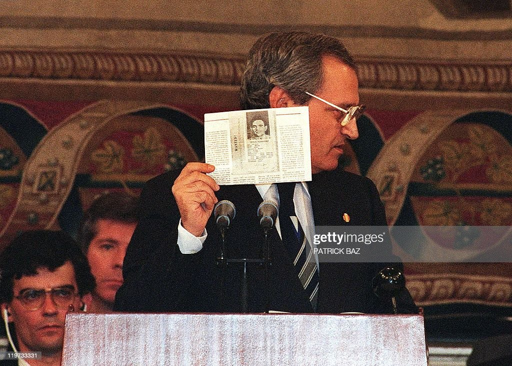 Syrian Foreign Minister Faruq alShara shows members of the Middle East Peace Conference a copy of an old wanted notice for Israel Prime Minister...