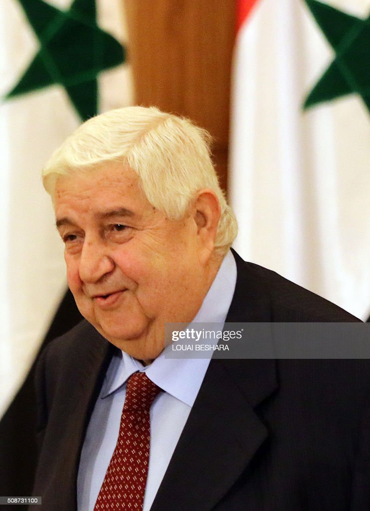 Syrian Foreign Minister Walid al-Muallem arrives for a news conference in Damascus on February 6, 2016. Muallem warned that Syria's forces would resist any foreign ground intervention after reports that Saudi Arabia and Turkey, which both support rebel forces, could send in troops. / AFP / LOUAI BESHARA