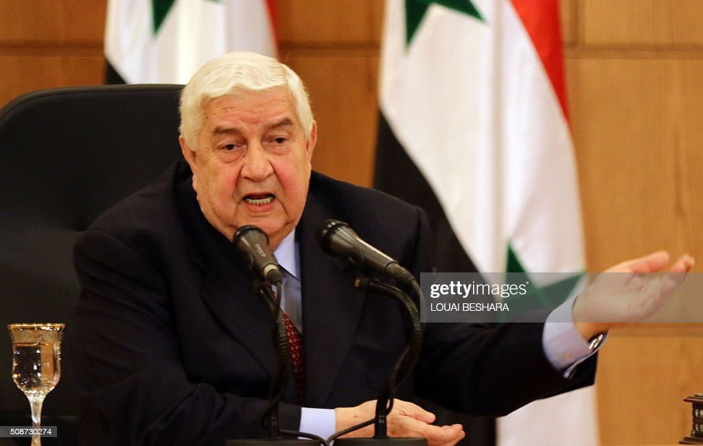 Syrian Foreign Minister Walid al-Muallem talks to media during a news conference in Damascus on February 6, 2016. Muallem warned that Syria's forces would resist any foreign ground intervention after reports that Saudi Arabia and Turkey, which both support rebel forces, could send in troops. / AFP / LOUAI BESHARA