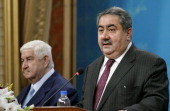 Syrian Foreign Minister Walid Muallem gives a joint press conference with his Iraqi counterpart Hoshyar Zebari in the Iraqi capital Baghdad on May 26...