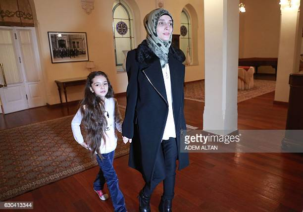 Syrian girl Bana alAbed known as Aleppo's tweeting girl and her mother Fatemah arrive for an interview in Ankara Turkey on December 22 2016 The young...