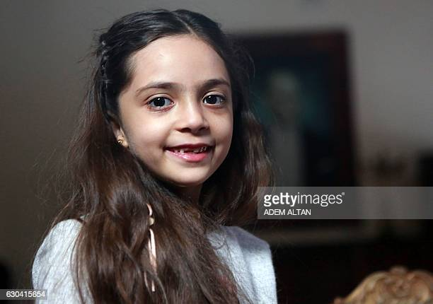 Syrian girl Bana alAbed known as Aleppo's tweeting girl poses during an interview in Ankara Turkey on December 22 2016 The young Syrian girl was one...