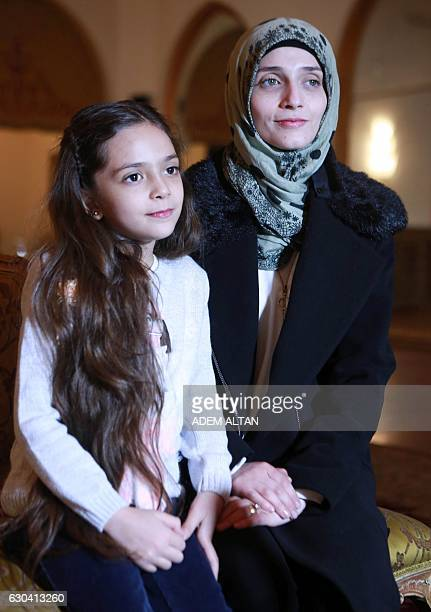 Syrian girl Bana alAbed known as Aleppo's tweeting girl poses with her mother Fatemah during an interview in Ankara Turkey on December 22 2016 The...