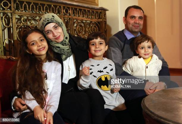 Syrian girl Bana alAbed known as Aleppo's tweeting girl poses with her family her mother Fatemah her father Ghassan and her brothers Nour and Laith...
