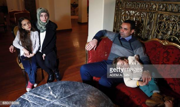 Syrian girl Bana alAbed known as Aleppo's tweeting girl poses with her mother Fatemah her father Ghassan and one of his brothers Laith during an...