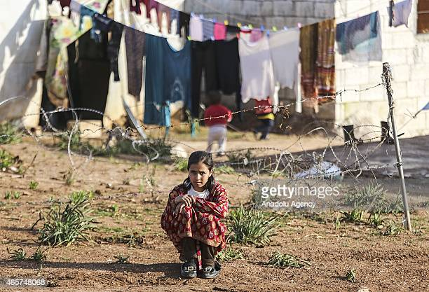 Syrian girl is seen in a refugee camp near Atme town of Syria on the border with Turkey March 9 2015 Syrians fleeing war and left their homes in Atme...