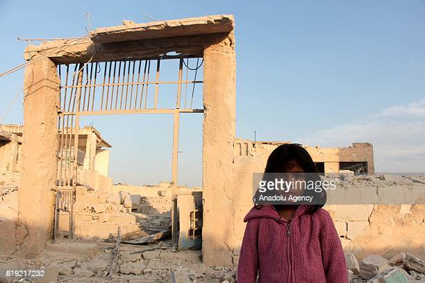 Syrian girl is seen in front of the Haas School which was destroyed by the vacuum bomb attacks carried out by the Syrian regime and allied war planes...