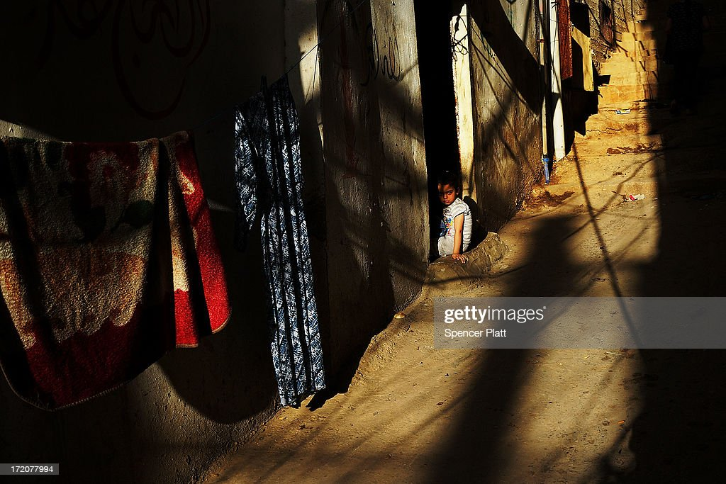 A Syrian girl named Ghina (3) from the city of Dara'a pauses in the doorway of her home she shares with extended members of her family in a poor neighborhood with a high concentration of Syrian refugees on July 01, 2013 in Beirut, Lebanon. Currently the Lebanese government officially hosts 546,000 Syrians with an estimated additional 500,000 who have not registered with the United Nations. Lebanon, a country of only 4 million people, is now home to the largest number of Syrian refugees who have fled the conflict. The situation is beginning to put a huge social and political strains on Lebanon as there is currently no end in sight to the war in Syria.
