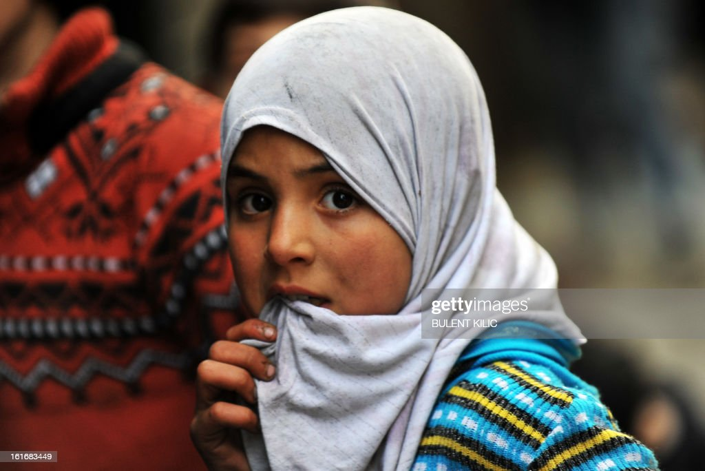 A Syrian girl waits in the line for water in the northern city of Aleppo on February 14, 2013. Syrian Foreign Minister Walid al-Muallem and opposition National Coalition chief Ahmed Moaz al-Khatib will make separate visits to Moscow for talks in the coming weeks, a top Russian diplomat said.