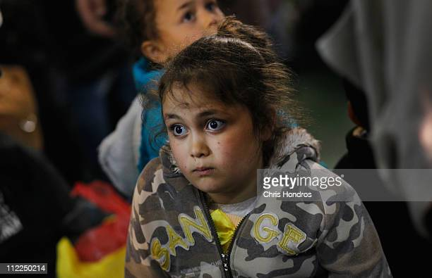 Syrian girl waits with her family to disembark a ship that evacuated them from the besieged city of Misrata April 15 2011 in Benghazi Libya Nearly...