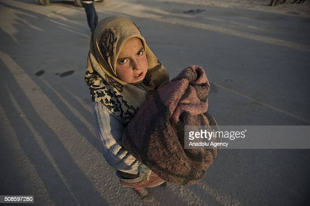 Syrian girl who fled bombing in Aleppo is seen as she waits at the Bab alSalam crossing opposite the Turkish province of Kilis in Azaz town of Aleppo...