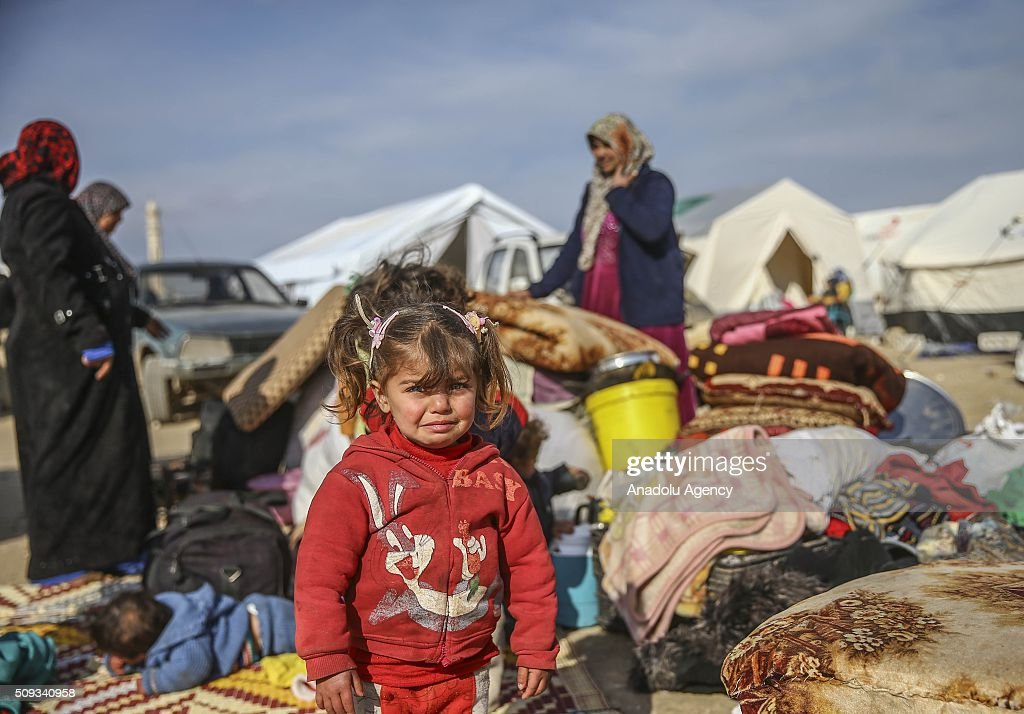 A Syrian girl who flee the attacks of Syrian and Russian air forces, cries as they shelter at tents and try to live their lives with humanitarian aid send by Turkey, UNHCR and other Turkish Humanitarian aid organizations, close to the Bab al-Salameh border crossing on Turkish-Syrian border near Azaz town of Aleppo, Syria on February 10, 2016.