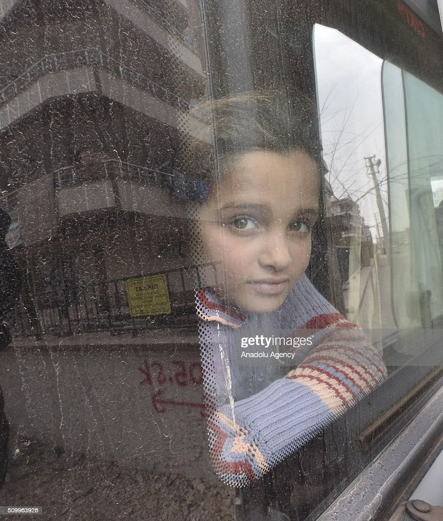 A Syrian girl, who has lost her parents in the country's civil war, is seen in a bus after the Sanliurfa Humanitarian Aid Platform provided clothes and toys to her in Sanliurfa, Turkey on February 13, 2016. The platform, which was established to carry out activities to help Syrian children, gave joy to children who had lost their parents in the Suleiman Shah camp. 115 children were brought to the Sanliurfa Humanitarian Aid Platform Charity Shop by minibuses to choose clothes for themselves.