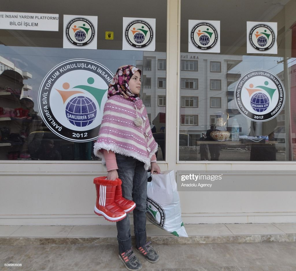 A Syrian girl, who has lost her parents in the country's civil war, is seen after the Sanliurfa Humanitarian Aid Platform provided clothes and toys to her in Sanliurfa, Turkey on February 13, 2016. The platform, which was established to carry out activities to help Syrian children, gave joy to children who had lost their parents in the Suleiman Shah camp. 115 children were brought to the Sanliurfa Humanitarian Aid Platform Charity Shop by minibuses to choose clothes for themselves.