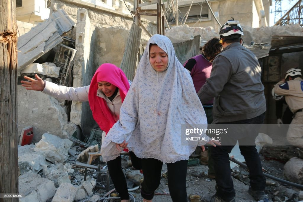 Syrian girls react following a reported Syrian regime air strike in a rebelcontrolled area in the northern city of Aleppo on February 8 2016 Regime...