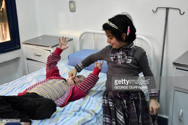 Syrian girls who had been held prisoner by opposition forces await treatment at a hospital in Aleppo on April 12 upon their release as part of an...