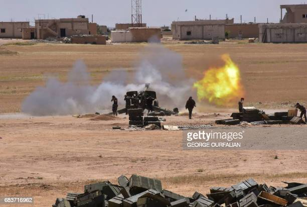TOPSHOT Syrian government forces fire artillery during a battle against the Islamic State group on May 16 2017 in the town of Maskana on the edge of...