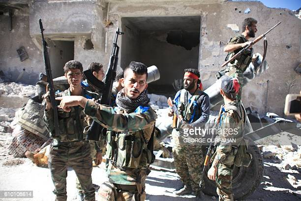 TOPSHOT Syrian government forces gather in the largely deserted Palestinian refugee camp of Handarat north of Aleppo on September 24 2016 after they...