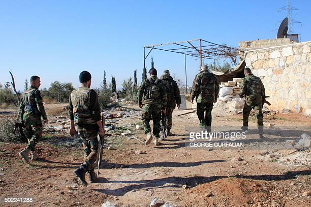 Syrian government forces inspect an area near the village of Khan Tuman south from the provincial capital Aleppo on December 22 two days after army...