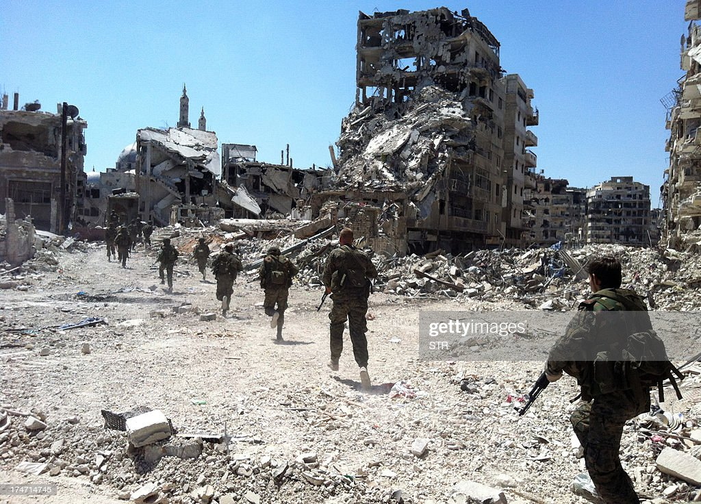 Syrian government forces patrol in the Khalidiyah neighbourhood of the central city of Homs on July 28, 2013. Government forces bolstered by Lebanese Shiite militiamen were poised to retake the largest rebel-held district of Syria's third city Homs, a watchdog and state media said.