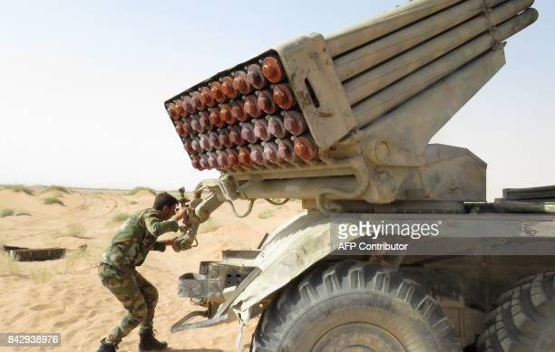 Syrian government forces prepare to fire a multiple rocket launcher from a position in Kobajjep area on the southwestern outskirts of Deir Ezzor on...