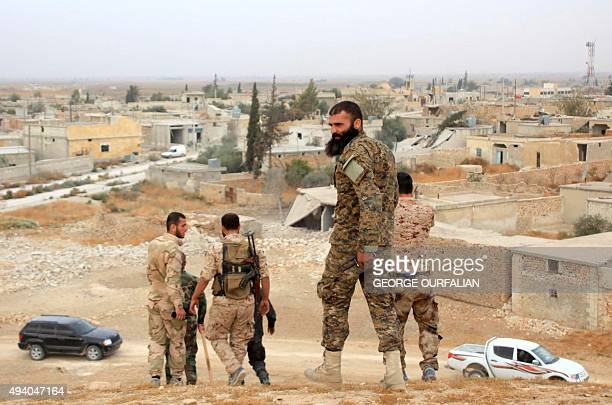 Syrian government forces walk in the village of Jabboul on the eastern outskirts of the northern Syrian city of Aleppo after taking control of the...