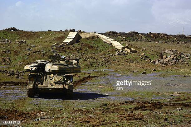 A Syrian government tank is seen stationed on a hill in the village of Himrit north of the southern Syrian city of Deraa on March 1 2015 AFP PHOTO /...