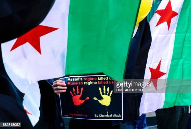 Syrian immigrant living in Bulgaria holds a placard on April 7 in front of Syrian embassy in Sofia during a protest against chemical attack in the...