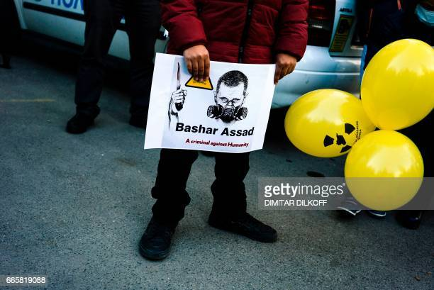 A Syrian immigrant living in Bulgaria holds a placard on April 7 in front of Syrian embassy in Sofia during a protest against chemical attack in the...
