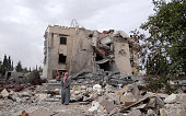 Syrian inspects the rubble of destroyed building allegedly belonging to AlNusra Front following the USled coalition's airstrikes against the Islamic...
