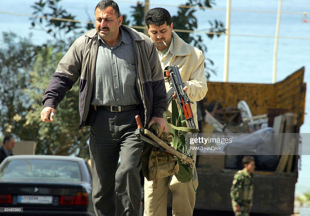 Syrian Armed Forces (Photos, Video) - Page 6 Syrian-intelligence-officers-carry-their-guns-as-they-prepare-to-the-picture-id52432350