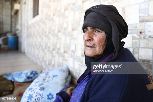 Syrian Khaldiyah a seventyoneyear old widow who was displaced from the town of Maidaa due to the ongoing fighting sits outside her home in the town...