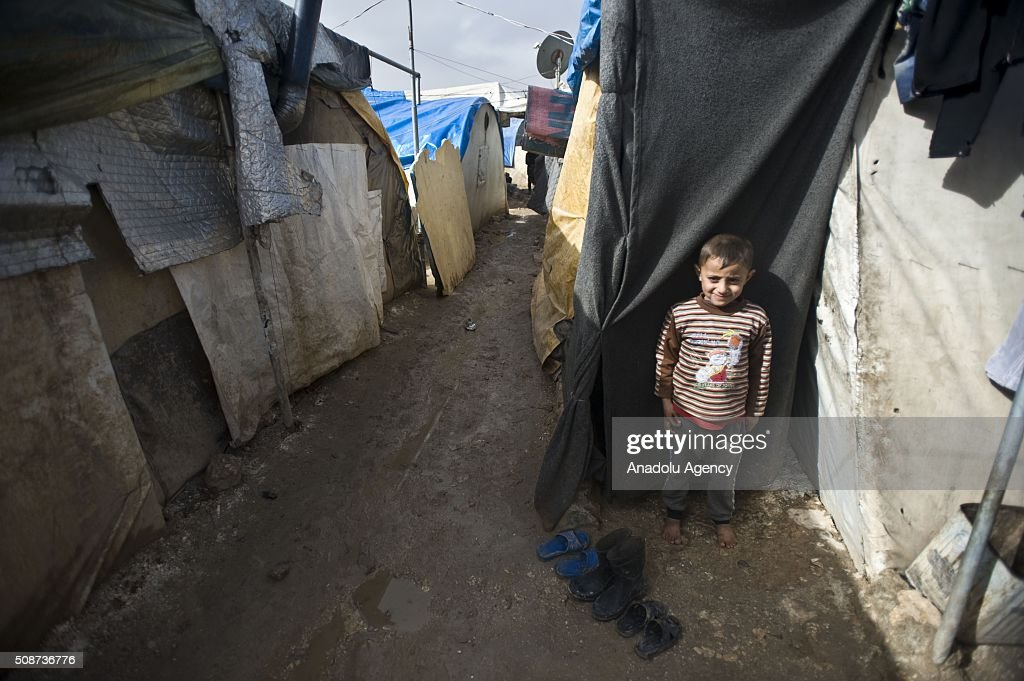 A Syrian kid is seen at tent city built by IHH Humanitarian Relief Foundation near the Bab al-Salam border gate on Turkey's border in Azez district of Aleppo as they flee to Turkey to escape heavy Syrian regime and Russian airstrikes, on February 6, 2016.