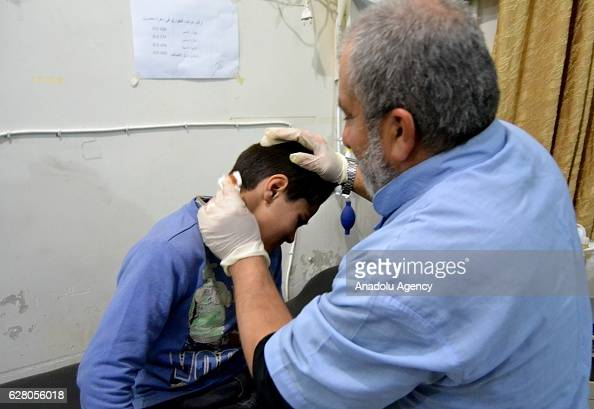 Syrian kid receives medical treatment at field hospital after war crafts belonging to the Assad Regime forces carried out airstrike over residential...