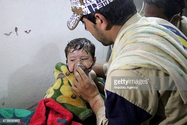 Syrian kid receives treatment at a field hospital following a suspected chlorine gas attack by Assad regime forces in Mishmishan village of Jisr...
