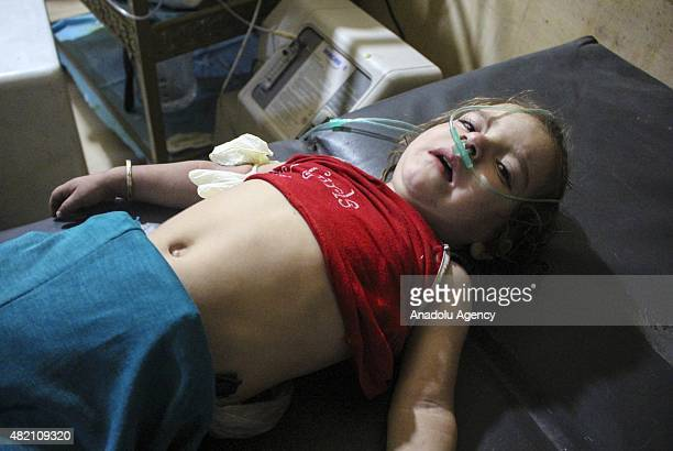 Syrian kid receives treatment at a field hospital following a chlorine gas attack by Assad regime forces in Ayn Tarma town of Damascus Syria on July...