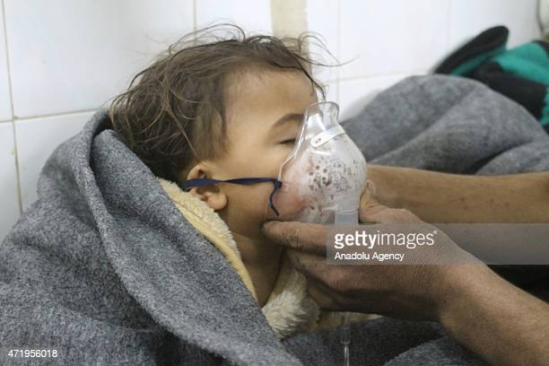 Syrian kid receives treatment at a hospital following a suspected chlorine gas attack by Assad regime forces in Idlib Syria on May 01 2015