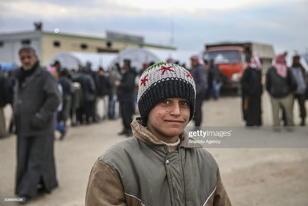 A Syrian kid, who fled bombing in Aleppo, gestures at a tent city close to the Bab al-Salam border crossing on Turkish-Syrian border near Azaz town of Aleppo, Syria on February 13, 2016. Russian airstrikes have recently forced some 40,000 people to flee their homes in Syrias northern city of Aleppo.