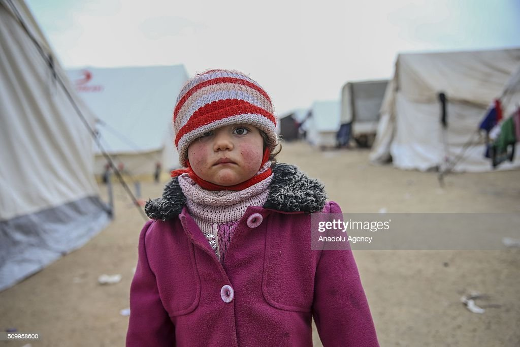 A Syrian kid, who fled bombing in Aleppo, is seen at a tent city close to the Bab al-Salam border crossing on Turkish-Syrian border near Azaz town of Aleppo, Syria on February 13, 2016. Russian airstrikes have recently forced some 40,000 people to flee their homes in Syrias northern city of Aleppo.