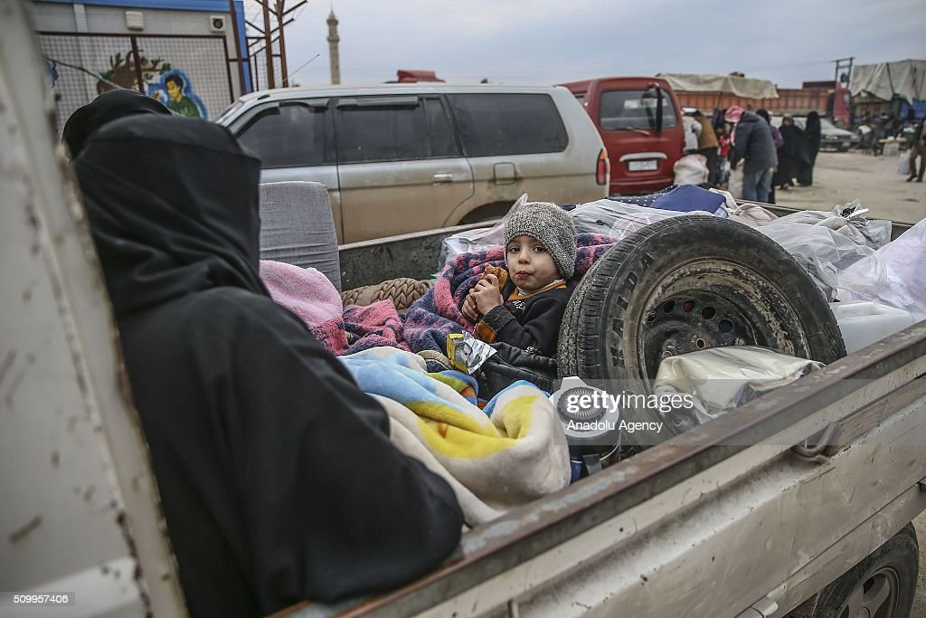 A Syrian kid, who fled bombing in Aleppo, is seen on at a tent city close to the Bab al-Salam border crossing on Turkish-Syrian border near Azaz town of Aleppo, Syria on February 13, 2016. Russian airstrikes have recently forced some 40,000 people to flee their homes in Syrias northern city of Aleppo.