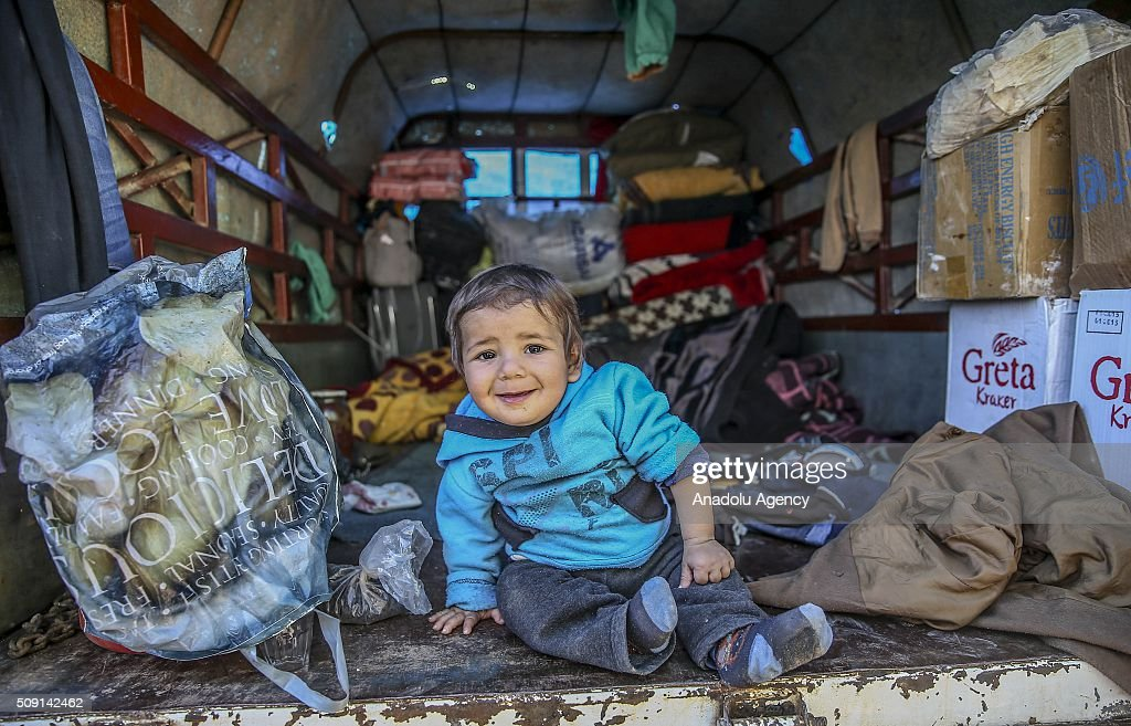 A Syrian kid, who flee the attacks of Assad Regime and Russian air forces, gestures as he and his family try to live inside their vehicle, at a refugee camp at the Bab al-Salameh border crossing on Turkish-Syrian border near Azaz town of Aleppo, Syria on February 09, 2016.