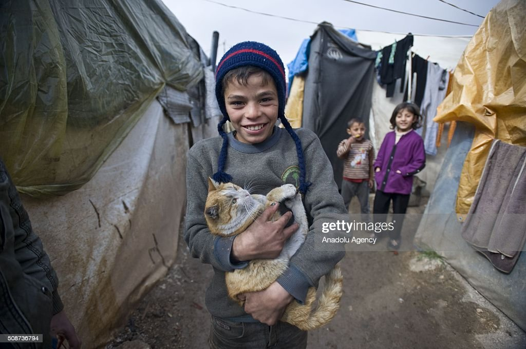 Syrian kids are seen in tent city built by IHH Humanitarian Relief Foundation near the Bab al-Salam border gate on Turkey's border in Azez district of Aleppo as they flee to Turkey to escape heavy Syrian regime and Russian airstrikes, on February 6, 2016.
