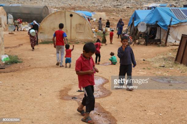 Syrian kids are seen outside of their tents during Muslim's holy month of Ramadan in Idlib Syria on June 23 2017 Ahead of Eid al Fitr Syrian people...