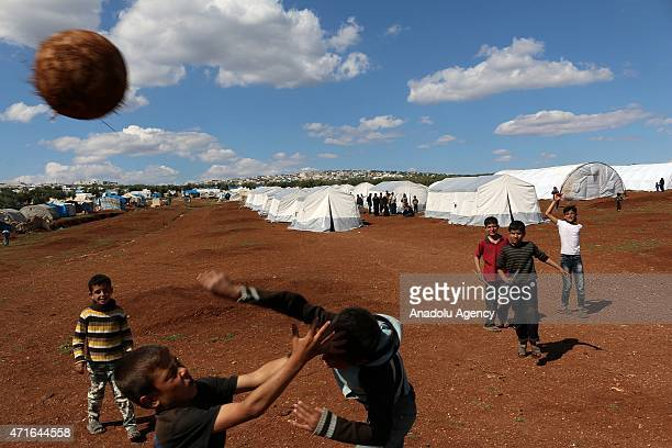 Syrian kids play footballl in Atma Refugee Camp in Atma village of Idlib Syria on April 30 2015 Syrians children fled with their families from multi...