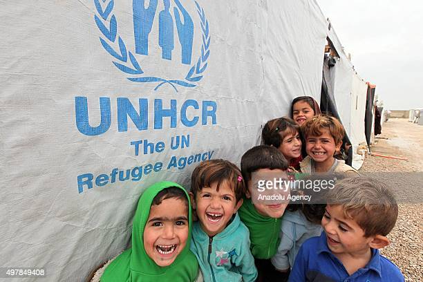 Syrian kids pose for a photograph at the refugee camp of Beqaa Valley in Beirut Lebanon on November 19 2015