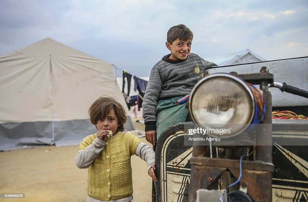 Syrian kids, who fled bombing in Aleppo, are seen at a tent city close to the Bab al-Salam border crossing on Turkish-Syrian border near Azaz town of Aleppo, Syria on February 13, 2016. Russian airstrikes have recently forced some 40,000 people to flee their homes in Syrias northern city of Aleppo.