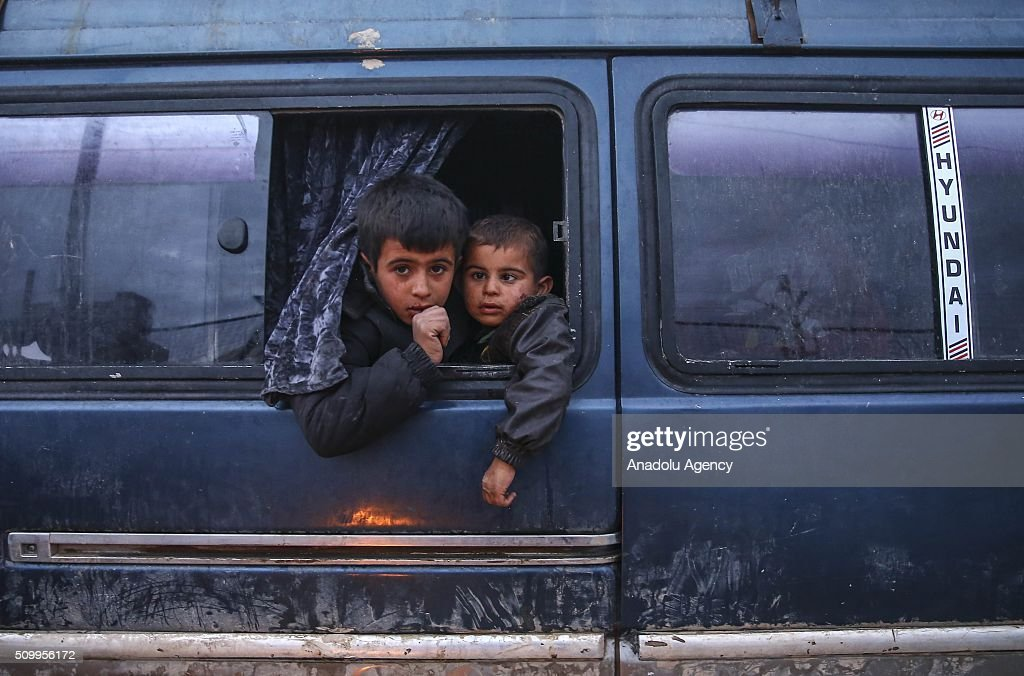 Syrian kids, who fled bombing in Aleppo, gestures are seen at a tent city close to the Bab al-Salam border crossing on Turkish-Syrian border near Azaz town of Aleppo, Syria on February 13, 2016. Russian airstrikes have recently forced some 40,000 people to flee their homes in Syrias northern city of Aleppo.