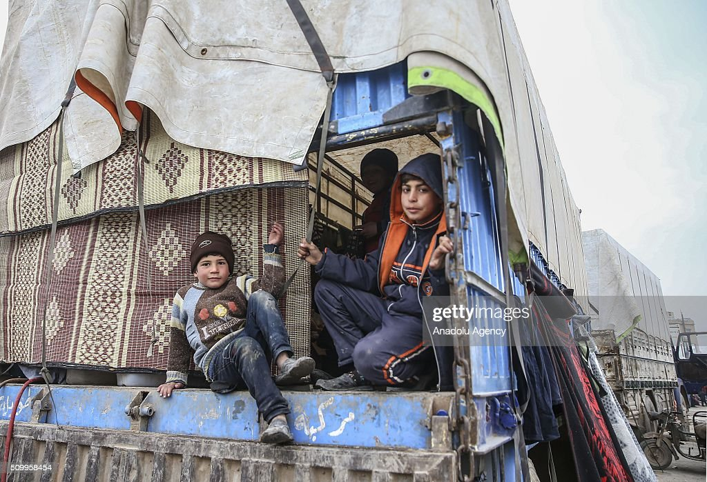 Syrian kids, who fled bombing in Aleppo, sit on truck haulage at a tent city close to the Bab al-Salam border crossing on Turkish-Syrian border near Azaz town of Aleppo, Syria on February 13, 2016. Russian airstrikes have recently forced some 40,000 people to flee their homes in Syrias northern city of Aleppo.