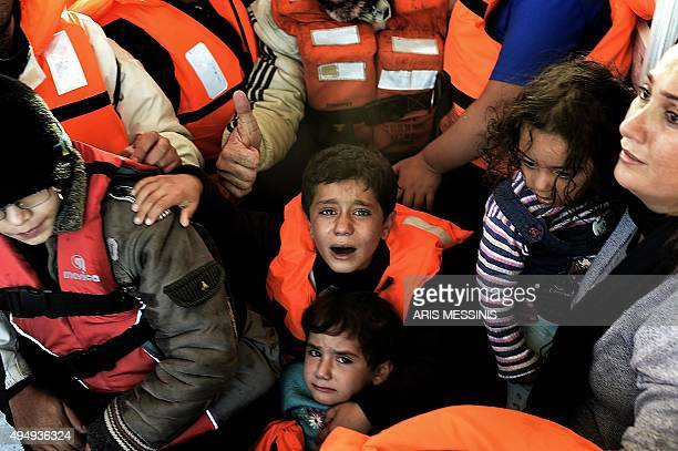 Syrian Kurdish refugees are rescued by Greek fishermen as the boat they had boarded sinks off the Greek island of Lesbos after crossing the Aegean...